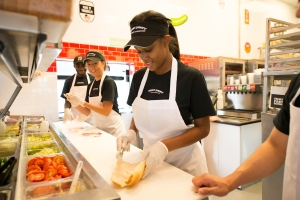 Jimmy_John_employees_having_fun_making_sandwiches