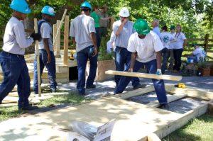 Volunteers building footbridge
